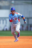 Kyle Schwarber (12) of the Tennessee Smokies takes off for third base against the Birmingham Barons at Regions Field on May 3, 2015 in Birmingham, Alabama.  The Smokies defeated the Barons 3-0.  (Brian Westerholt/Four Seam Images)