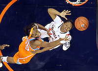 CHARLOTTESVILLE, VA- NOVEMBER 20: Glory Johnson #25 of the Tennessee Lady Volunteers reaches for the rebound with Telia McCall #30 of the Virginia Cavaliers during the game on November 20, 2011 at the John Paul Jones Arena in Charlottesville, Virginia. Virginia defeated Tennessee in overtime 69-64. (Photo by Andrew Shurtleff/Getty Images) *** Local Caption *** Telia McCall;Glory Johnson