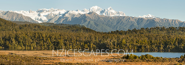 Views of Southern Alps with Aoraki Mount Cook, Mount Tasman and Franz Josef Glacier over coastal lagoon, Westland Tai Poutini National Park, UNESCO World Heritage Area, West Coast, New Zealand, NZ
