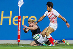 Hong Kong plays Japan during the17th Asian Games 2014 Rugby Mens Sevens tournament on October 02, 2014 at the Namdong Asiad Rugby Field in Incheon, South Korea. Photo by Alan Siu / Power Sport Images