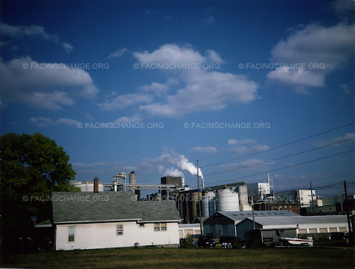 Iowa, Davenport, <br /> USA<br /> August 2008<br /> <br /> A view of homes next to a factory.