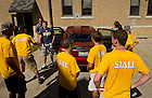 Aug. 23, 2013; Morrissey Manor staff greet a first-year resident on move-in day.<br /> <br /> Photo by Matt Cashore/University of Notre Dame