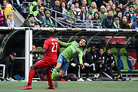 SEATTLE, WA - NOVEMBER 10: Victor Rodriguez #8 of the Seattle Sounders FC is defended by Chris Mavinga #23 of Toronto FC during a game between Toronto FC and Seattle Sounders FC at CenturyLink Field on November 10, 2019 in Seattle, Washington.