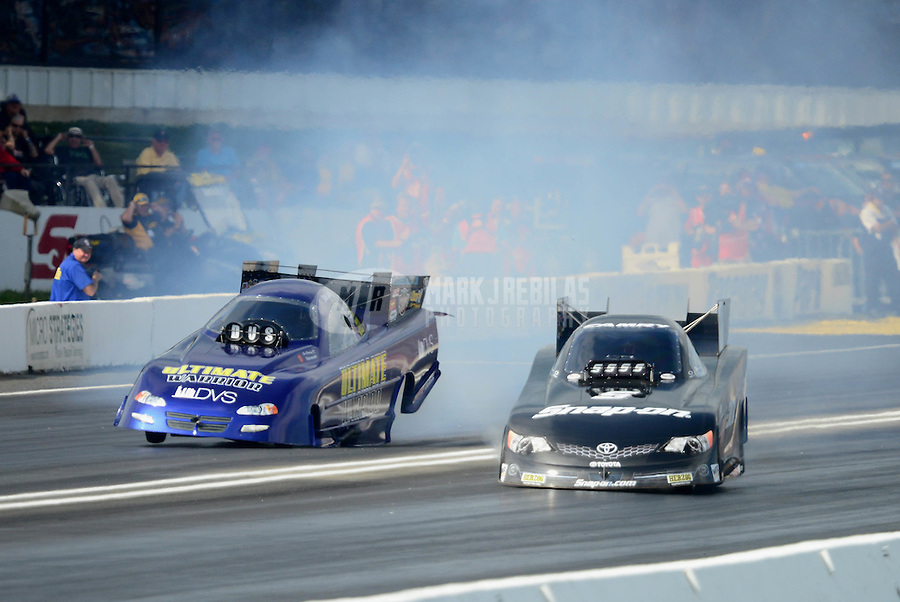 Jun. 2, 2012; Englishtown, NJ, USA: NHRA funny car driver Cruz Pedregon (right) alongside Mike Smith during qualifying for the Supernationals at Raceway Park. Mandatory Credit: Mark J. Rebilas-