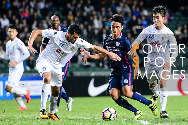 FC Kitchee Midfielder Ka Wai Lam (c) fights for the ball with FC Hanoi Defender Alvaro Silva (l) during the AFC Champions League 2017 Preliminary Stage match between  Kitchee SC (HKG) vs Hanoi FC (VIE) at the Hong Kong Stadium on 25 January 2017 in Hong Kong, Hong Kong. Photo by Marcio Rodrigo Machado/Power Sport Images