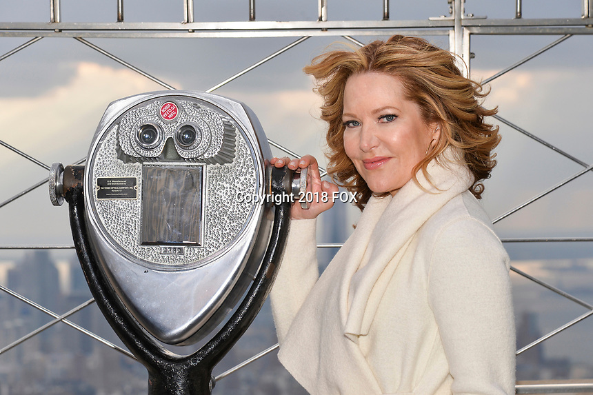"""New York - DECEMBER 17: Stephanie Gillis participates in the ceremonial lighting of the Empire State Building as they attend the Empire State Building Celebration of the 30th Anniversary of FOX's """"The Simpsons"""" on December 17, 2018 in New York City.  (Photo by Anthony Behar/FOX/PictureGroup)"""