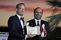 CANNES, FRANCE - JULY 17: Juho Kuosmanen and Asghar Farhadi pose with the 'Grand Prix' Ex-Aequo for 'Hytti nro 6' and for 'A Hero' during the 74th annual Cannes Film Festival on July 17, 2021 in Cannes, France. <br /> CAP/GOL<br /> ©GOL/Capital Pictures