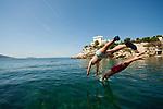 Boys dive off the rocks below Le Petit Nice Passedat, Marseille, 16.06.2011
