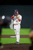 Auburn Doubledays pitcher Rafael Gomez (12) during a NY-Penn League game against the West Virginia Black Bears on August 23, 2019 at Falcon Park in Auburn, New York.  West Virginia defeated Auburn 6-5, the second game of a doubleheader.  (Mike Janes/Four Seam Images)