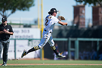 Surprise Saguaros shortstop Cole Tucker (2), of the Pittsburgh Pirates organization, throws to first base on the run during an Arizona Fall League game against the Salt River Rafters on October 9, 2018 at Surprise Stadium in Surprise, Arizona. Salt River defeated Surprise 10-8. (Zachary Lucy/Four Seam Images)