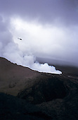 Big Island, Hawaii. Aerial view of steam and other gases escaping from Pu'u O'o vent of Kilauea volcano with helicopter above.
