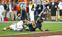 STANFORD, CA - January 2, 2012: Oklahoma State wide receiver Colton Chelf (83) attempts to score against Stanford at the Fiesta Bowl at University of Phoenix Stadium in Phoenix, AZ. Final score Oklahoma State wins 41-38.