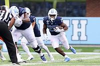 CHAPEL HILL, NC - OCTOBER 10: Javonte Williams #25 of North Carolina rushes the ball for 14 yards during a game between Virginia Tech and North Carolina at Kenan Memorial Stadium on October 10, 2020 in Chapel Hill, North Carolina.