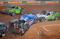 Dec. 11, 2011; Chandler, AZ, USA; LOORRS pro two unlimited driver Robby Woods (99) crashes in traffic during the Lucas Oil Challenge Cup at Firebird International Raceway. Mandatory Credit: Mark J. Rebilas-