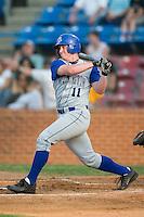 Wilmington outfielder Brian Mc Fall (11) follows through on his swing versus Winston-Salem at Ernie Shore Field in Winston-Salem, NC, Saturday, June 9, 2007.
