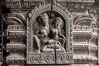 Nepal, Patan.  Hindu Temple Column Showing Carving Depicting Shiva and Parvati.