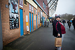 A home fan waiting for the turnstiles to open at the stadium before Burnley hosted Everton in an English Premier League fixture at Turf Moor. Founded in 1882, Burnley played their first match at the ground on 17 February 1883 and it has been their home ever since. The visitors won the match 5-1, watched by a crowd of 21,484.