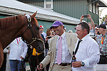May 17, 2014. California Chrome joins his exercise rider, Wilie Delgado (purple hat), and assistant trainer Alan Sherman back at the stakes barn after winning the 139th Preakness Stakes at Pimlico Race Course in Baltimore, MD. ©Joan Fairman Kanes/ESW/CSM
