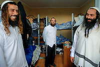 UKRAINE, Uman, 2008/09..Students from Israel travelled to Ukraine for a visit to the tomb of Rabbi Nachman of Breslov. Local inhabitants vacate their apartments to rent them out to pilgrims. The rooms have no mirrors, and bathtubs are replaced with showers, according to Hasidim's requirements. .© Cyril Horiszny / EST&OST