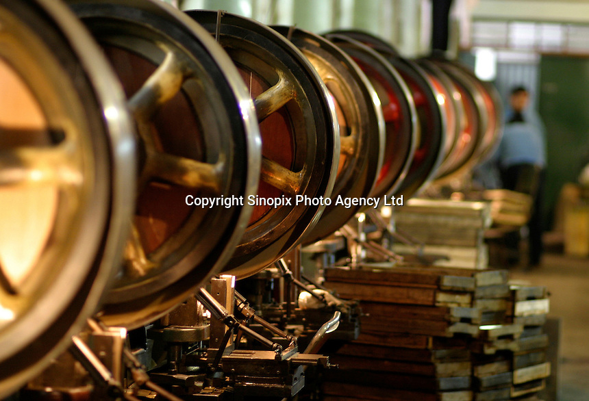 Idle machines line a hall at the Shanghai General Harmonica Factory (SGHF) in Shanghai, China. Although it makes well-respected brands such as the Huang, Suzuki, and Hohner harmonicas that are favored by many professional musicians around the world, the 60 years old state owned SGHF had to trim down its work force from 800 in the mid 1980's to just over 100 today..23-FEB-04
