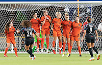 Allysha Chapman #2, Haley Hanson #9, Sophie Schmidt #13, Rachel Daly #3, Kristie Mewis #19, and Katie Naughton #25 of the Houston Dash attempt to block a penalty kick during a game between Chicago Red Stars and Houston Dash at BBVA Stadium on September 10, 2021 in Houston, Texas.