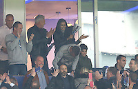 Rita Mahrez, wife of Riyad use a clapper to cheer on the team during the Barclays Premier League match between Leicester City and Swansea City played at The King Power Stadium, Leicester on 24th April 2016