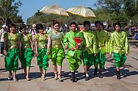 Cambodia, Angkor Wat.  Wedding Party Walking toward the Temple.