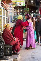 Fes, Morocco.Women about to Say Farewell, Tala'a Kabira Street in the Medina.