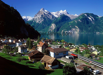 Switzerland, Canton Uri, Sisikon: view across Sisikon and Urner lake (part of Lake Lucerne) at Uri Rotstock mountain (2.928 m)