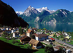 Switzerland, Canton Uri, Sisikon: view across Sisikon and Urner lake (part of Lake Lucerne) at Uri Rotstock mountain (2.928 m)