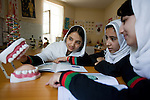 16 June 2013, Qala Wazir, Khoshal Khan, Kabul Province,  Afghanistan.  Students (from left)  Metra Barakzai (16), Masuda Sarwri (15), and Hena Saadat (16) during an anatomy class at  Shahid Nahid High School in Kabul.   Much of the funding for the school, including construction, was provided by the Education Quality Improvement Program (EQUIP). The school is benefitting from EQUIP whose objective is to increase access to quality basic education, especially for girls. School grants and teacher training programs are strengthened by support from communities and private providers.  Picture by Graham Crouch/World Bank