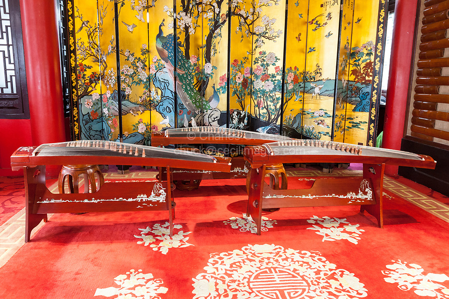 Yangzhou, Jiangsu, China.  Three Guzhengs, a Traditional Chinese Stringed Instrument.  Slender West Lake Park.