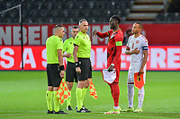 referee Athanasios Tzilos from Greece , Amadou Onana (6) of Belgium and Nikolas Nartey (6) of Denmark pictured before a soccer game between the national teams Under21 Youth teams of Belgium and Denmark on the fourth matday in group I for the qualification for the Under 21 EURO 2023 , on tuesday 12 th of october 2021  in Leuven , Belgium . PHOTO SPORTPIX   STIJN AUDOOREN