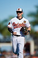 Baltimore Orioles left fielder Austin Hays (21) jogs back to the dugout during a Grapefruit League Spring Training game against the Detroit Tigers on March 3, 2019 at Ed Smith Stadium in Sarasota, Florida.  Baltimore defeated Detroit 7-5.  (Mike Janes/Four Seam Images)