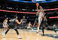 WASHINGTON, DC - FEBRUARY 19: Jamorko Pickett #1 of Georgetown passes over Alpha Diallo #11 and David Duke #3 of Providence during a game between Providence and Georgetown at Capital One Arena on February 19, 2020 in Washington, DC.