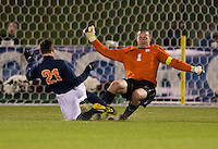 Scott Goodwin (1) of North Carolina goes to clear the ball away from Ryan Zinkhan (21) of Virginia during the game at the Maryland SoccerPlex in Germantown, MD. North Carolina defeated Virginia on penalty kicks after playing to a 0-0 tie in regulation time.  With the win the Tarheels advanced to the finals of the ACC men's soccer tournament.