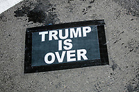 "A sign reading ""Trump is Over"" lays on the ground as demonstrators gather in Black Lives Matter Plaza near the White House on the night of Election Day in Washington, D.C., on Tue., Nov. 3, 2020. Election results remained uncertain late into the night and demonstrators were peaceful."
