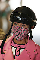 30th April 2021; Kentucky, USA;  Former jockey and NBC on the track announcer Donna Barton Brothers walks through the Paddock tunnel during Oaks Day on April 30, 2021 at Churchill Downs in Louisville, Kentucky.