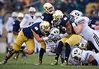 Nov. 23, 2013; Linebacker Dan Fox (48) and linebacker Jaylon Smith (13) bring down BYU Cougars running back Jamaal Williams (21) in the first quarter. Smith was wearing number 13 in honor of senior Danny Spond.<br /> <br /> Photo by Matt Cashore