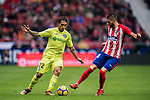 Damian Nicolas Suarez Suarez (L) of Getafe CF competes for the ball with Yannick Ferreira Carrasco of Atletico de Madrid during the La Liga 2017-18 match between Atletico de Madrid and Getafe CF at Wanda Metropolitano on January 06 2018 in Madrid, Spain. Photo by Diego Gonzalez / Power Sport Images