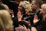 Dale Raggio, left, the widow of former Senator Bill Raggio and former First Lady Dema Guinn react to Nevada Gov. Brian Sandoval's State of the State address at the Legislature in Carson City, Nev., on Wednesday, Jan. 16, 2013. Sandoval proposed funding in his budget to continue the Kenny C. Guinn Millennium Scholarship fund. (AP Photo/Cathleen Allison)