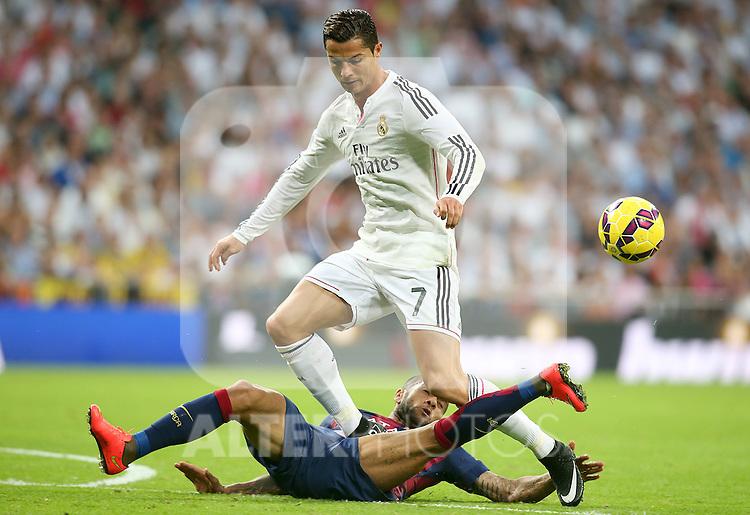 Real Madrid's Cristiano Ronaldo (r) and FC Barcelona's Daniel Alves during La Liga match.October 25,2014. (ALTERPHOTOS/Acero)