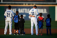 Rancho Cucamonga Quakes infielders Omar Estevez (21) and Gavin Lux (14) stand alongside Little League players during the National Anthem before a California League game against the Lake Elsinore Storm at LoanMart Field on May 18, 2018 in Rancho Cucamonga, California. Lake Elsinore defeated Rancho Cucamonga 5-4. (Zachary Lucy/Four Seam Images)