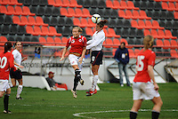 Carli Lloyd wins a header against a Norwegian player.  The USA defeated Norway 2-1 at Olhao Stadium on February 26, 2010 at the Algarve Cup.
