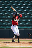 Miguel Aparicio (5) of the Hickory Crawdads at bat against the Greensboro Grasshoppers at L.P. Frans Stadium on May 26, 2019 in Hickory, North Carolina. The Crawdads defeated the Grasshoppers 10-8. (Brian Westerholt/Four Seam Images)