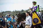 DEL MAR, CA - NOVEMBER 03: Javier Castellano, aboard Rushing Fall #11, passes flowers out after his victory on Day 1 of the 2017 Breeders' Cup World Championships at Del Mar Thoroughbred Club on November 3, 2017 in Del Mar, California. (Photo by Alex Evers/Eclipse Sportswire/Breeders Cup)