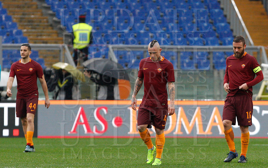 From left, Roma's Kostas Manolas, Radja Nainggolan and Daniele De Rossi react after Napoli's Dries Mertens, not seen, scored his second goal during the Italian Serie A football match between Roma and Napoli at Rome's Olympic stadium, 4 March 2017. Napoli won 2-1.<br /> UPDATE IMAGES PRESS/Riccardo De Luca