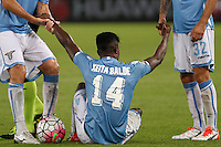 Calcio, Serie A: Lazio vs Udinese. Roma, stadio Olimpico, 13 settembre 2015.<br /> Lazio's Keita Diao is helped by his teammates during the Italian Serie A football match between Lazio and Udinese at Rome's Olympic stadium, 13 September 2015.<br /> UPDATE IMAGES PRESS/Isabella Bonotto