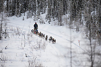 Dag Torulf Olsen runs down the road on his way to the Ophir Ceckpoint on Thursday March 10 during Iditarod 2016.  Alaska.    <br /> <br /> Photo by Jeff Schultz (C) 2016  ALL RIGHTS RESERVED