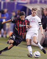 The MetroStars' Pablo Brenes battles the Revolution's Steve Ralston for the ball. The New England Revolution were defeated by the MetroStars 3 to 2 on Saturday September 11, 2004 at Giant's Stadium, East Rutherford, NJ..